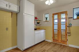 it has plenty of cabinets and counter space a nice chalk board inside the pantry the dishwasher and garbage disposal are newer the laminate floor was