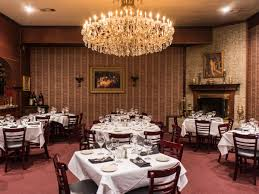 for an intimate wedding dinner that oozes old school class lower greenville fixture st martin s has a private back room decked out with white tablecloths