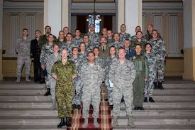 Students and instructors pose for a photo after graduation from the first  ever IEAFA course