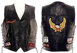 including born to be wild freedom isn t free and usa on the front part of the vest in the back you have route 66 ride free and a large eagle patch