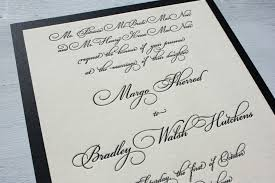these formal black letterpress wedding invitations feature a fancy script font and scroll in black ink on ecru cotton