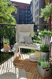 balcony gardens. 1. Pull Up A Bench: Keep Things Interesting By Pairing Little Bench And Seat Cushions With An Outdoor Rug Handy Side Table. Balcony Gardens