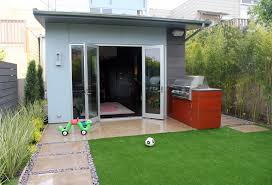 this little bbq area shows that a small backyard and little kids don t have to stop you from being able to have a stylish outdoor entertaining space
