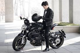 rich ceo on a motorcycle in rich man