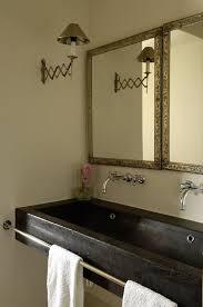bathroom with black trough sink