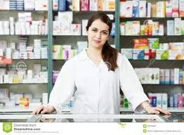 w in pharmacy being counseled by s lady stock photo pharmacy chemist w in drugstore royalty stock photography