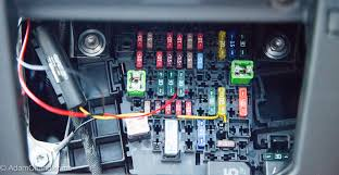 still no wiring diagram for our fuse box the yellow cable which runs the camera when the car was on is still int he same spot but i had moved the red cable to the 15 amp blue fuse at