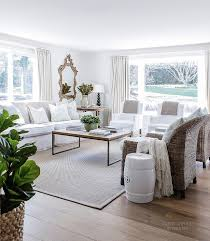 living room with wicker chairs and slipcovered sofa