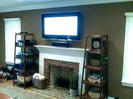 mounting tv on brick mount over fireplace mounted above fireplace hide wires wall mount above fireplace wall mount above