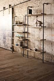 leaning wood and metal wall shelving unit could easily be used on a kitchen
