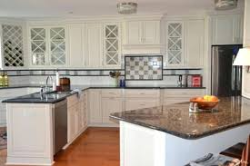 delightful kitchen with white cabinets and black countertops k4821683 white cabinets with black white kitchen cabinets