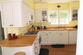light blue kitchen walls white cabinets and yellow accessories