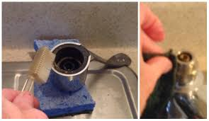 image of kitchen sink faucet leaking underneath single