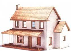 This farm-style scale dollhouse uses a sheathing-over-framing technique  common to full-size structures.