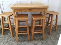 high wooden kitchen table with 4 stools