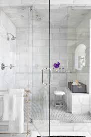 12 24 tile bathroom traditional with glass shower door marble walls metal towel
