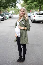 fall fashion for moms featuring graphic tees army green trench coat