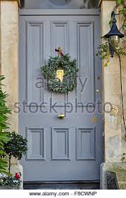 grey front doorChristmas wreath on grey front door hanging Stock Photo Royalty