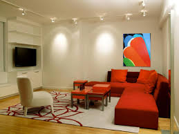 contemporary living room decorated with orange sectional sofa and illuminated with track lighting fixtures