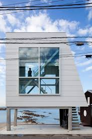 Small Picture Micro house by Yasutaka Yoshimura slotted between two huge windows