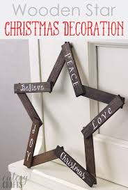 make this pretty wooden star diy decoration for your holiday mantle it s so easy
