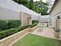Small Picture garden design using grass with retaining wall cubby house