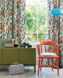 orange blue and green qindow curtains and room furniture