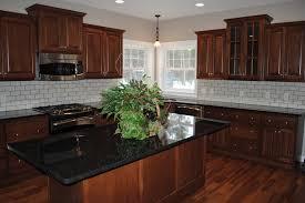 Granite In Kitchen Brown Kitchen Cabinets With Black Granite Quicuacom