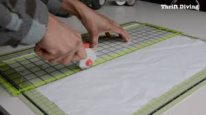 cutting out fabric for the diy privacy screen
