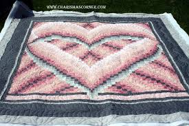 Heart Bargello & I have quilted several of these Heart Bargello quilts. It's a local pattern.  I have also made one and seen it made in several color ways. Adamdwight.com