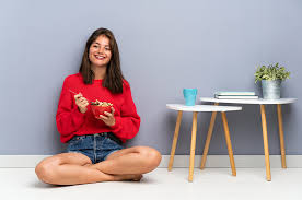 sitting on the floor while eating
