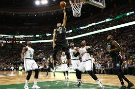 Image result for giannis dunking on celtics