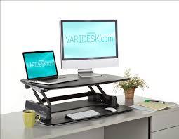 stand at desk to work up desks choose the varidesk 2