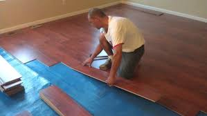how to put down fake wood flooring