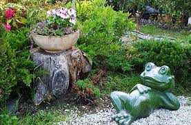 ... Flowering plants and frog garden accent for decorating tree stumps and  garden paths ...