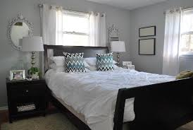 Light grey paint color with white furniture and decor for a clean, open  look.