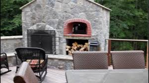 outdoor kitchen and stone fireplace with oven built into this deck you