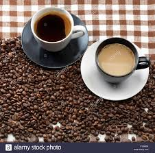 coffee cups with coffee beans. Simple Coffee Two Coffee Cups And Beans On A Checkered Cloth And Coffee Cups With Beans S