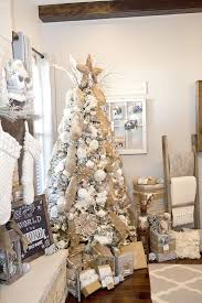 this white tree got a rustic vibe with burlap garlands and white ornaments