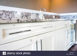 Modern Clean Wet Bar With Granite Countertop Cabinets Faucet In