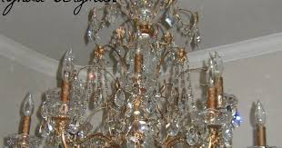 lynda bergman decorative artisan painting a beautiful chandelier from shiny brass to a darker metallic finish