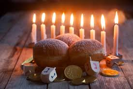 menorah donuts chockolate coins and wooden dreidels credit karaidel