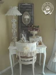 shabby chic white dressing table and chair like the use of the shutter behind