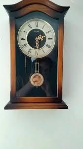 seiko pendulum wall clock pendulum wall clock seiko wall pendulum schoolhouse clock dark brown solid oak seiko pendulum wall clock
