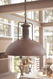 metal industrial pendant lighting in a distressed rustic charm