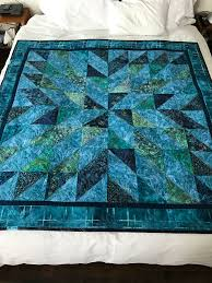 Starburst Quilt – Finished | jmn & However, I'm happy with the finished quilt. The dark narrow border and  binding help strengthen the contrast and the quilting design used draws a  bit of ... Adamdwight.com