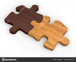 two wooden puzzle pieces put together stock photo