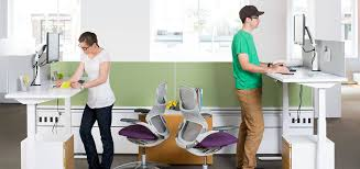 smart office interiors. Image May Contain: One Or More People, People Sitting, Shoes And Indoor Smart Office Interiors