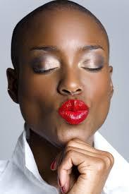 Black women look good with red lipstick.   Mademoiselle Antoine