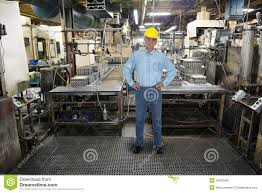 man working in industrial manufacturing warehouse stock photos smiling man work industrial manufacturing factory stock photography